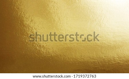 Gold foil gradient texture background with uneven surface      Foto stock ©