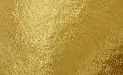 Gold foil texture background with uneven surface