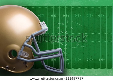 Gold football helmet against green football field with diagram