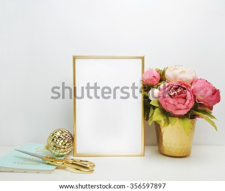Gold frame mock-up, and white wall with gold vase, and peonies Place work #356597897