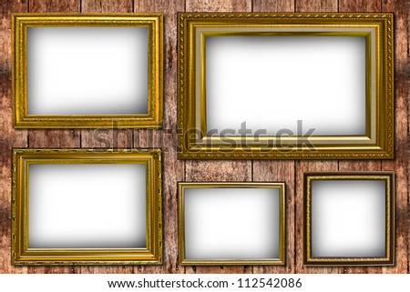 Gold frame on a wooden wall.