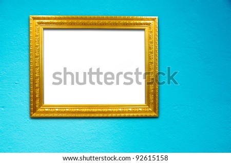 Gold frame on blue cement background
