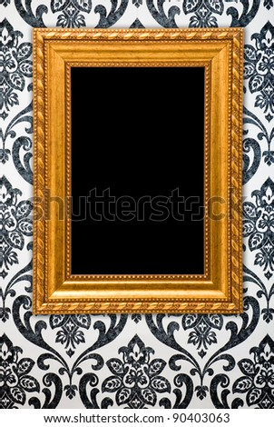 Gold frame on vintage wallpaper background
