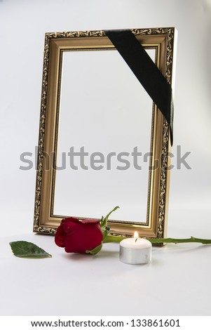 gold frame with sympathy rose