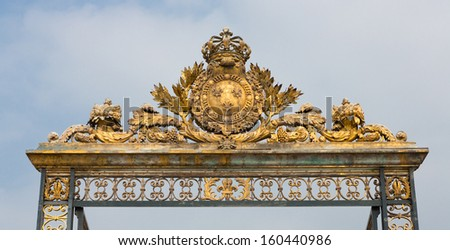 Gold gate at the palace of Versailles in Paris, France.