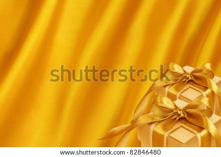 Gold Gift Box on gold satin background