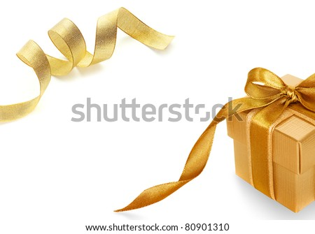 Gold gift box on white  background with Shiny gold satin ribbon on white background