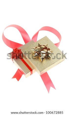 gold gift box with pink bow isolated over white background