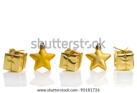 gold  gift boxes  and stars on white  background