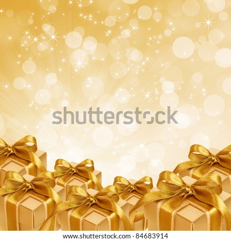 gold gift boxes on abstract gold Christmas background