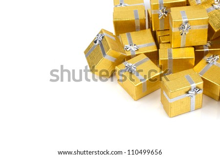 Gold gift boxes on white