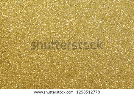 gold glitter abstract background with soft glowing backdrop texture for christmas and valentine.