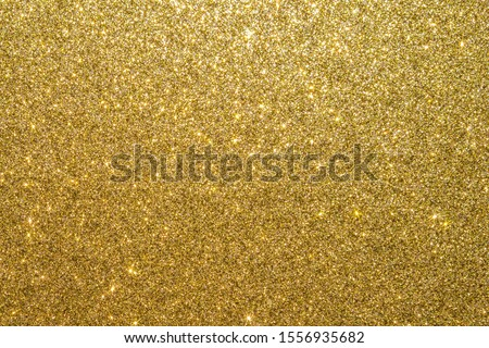 Gold glitter texture background sparkling shiny wrapping paper for Christmas holiday seasonal wallpaper  decoration, greeting and wedding invitation card design element Photo stock ©