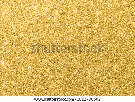 Gold glitter texture sparkling shiny wrapping paper background for Christmas holiday seasonal wallpaper  decoration, greeting and wedding invitation card design element #1012790602