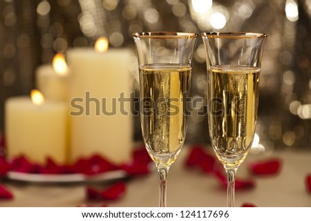 Gold glitter Wedding reception setting with champagne and candles