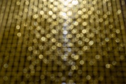 Gold glittering Blurred abstract background. Gold Holiday New year Abstract Glitter Defocused Background,  Blurred Bokeh, Idea for Christmas, New year and Happy hollidays background