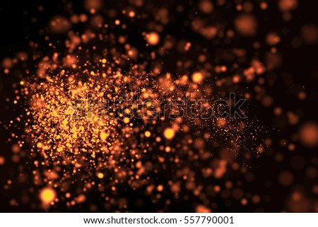 Photo of  gold glow glittering particles bokeh tail transition sparkle effect on black background, holiday happy new year concept