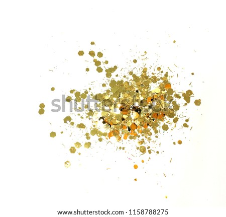 Gold.Gold dust.Sequins.Tinsel.Jewelry shop.Decoration.Firework.Valentine's Day.Isolated white background. #1158788275