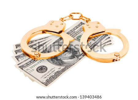 gold handcuffs with money isolated in white background