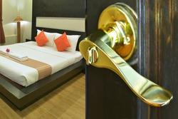 Gold handle open door of bed room