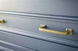 gold hardware on blue cabinets