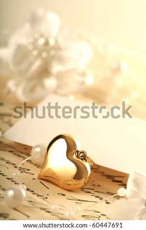 gold heart and wedding invitation