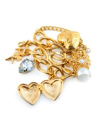 Gold heart in necklace isolated on white background