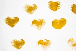 Gold hearts against white background. Golden Abstract  hearts pattern. Handmade design elements for use.Painted grunge hearts set  for background and paint texture