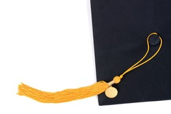 gold honor graduation tassel and mortarbaord isolated white background school concept