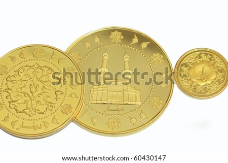 Gold in dinar with isolated white background