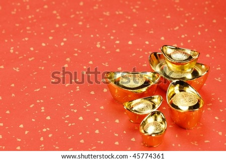gold ingot on festive background.