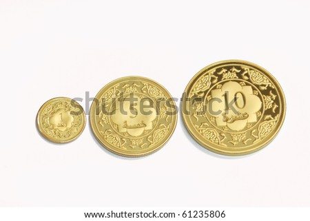 Gold islamic dinar on isolated white background - stock photo