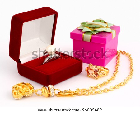 gold jewellery and gift box on white background
