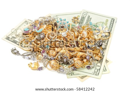 Gold jewelry and dollars on white background