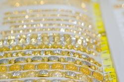Gold jewelry diamond shop with bracelet luxury retail store window display