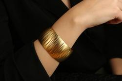 Gold jewelry. Gold bracelet on woman