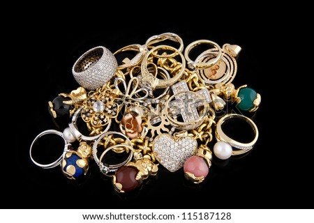Gold jewelry on a black background
