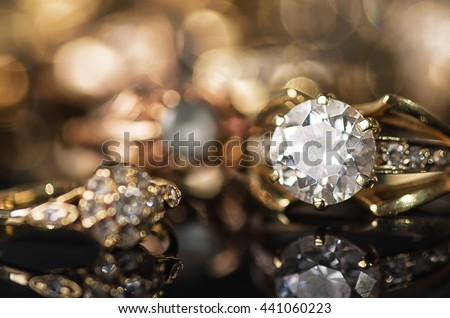 Gold jewelry on a black background.