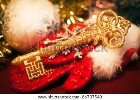 Gold key against Christmas toys