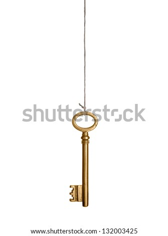 Gold key, hanging on a string. Isolated on white.