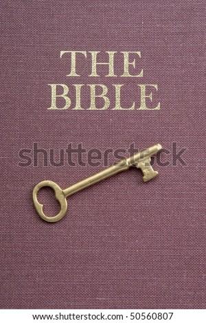 gold key on Bible