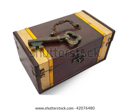 Gold  key on closed treasure chest , isolated with clipping path