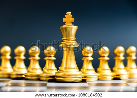 Gold king chess piece stand in front of pawn on black background (Concept of leadership, management) #1080184502