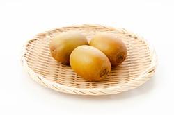 gold kiwi fruit on Bamboo sieve on white background