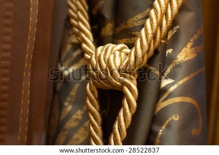 Gold knot on luxury curtain tassel