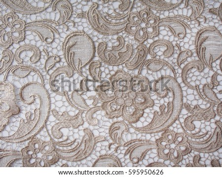 gold lace fabric. flowers. lace.