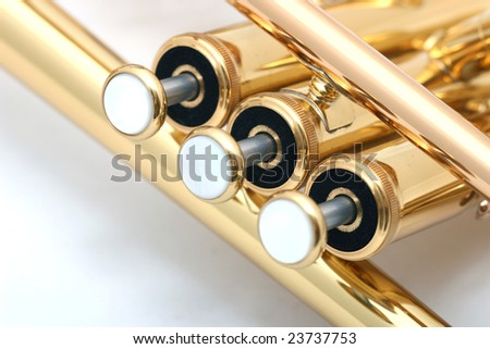 gold lacquer trumpet valves close up