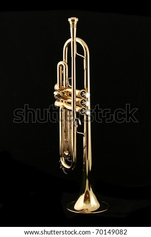 gold lacquer trumpet with mouthpiece on black