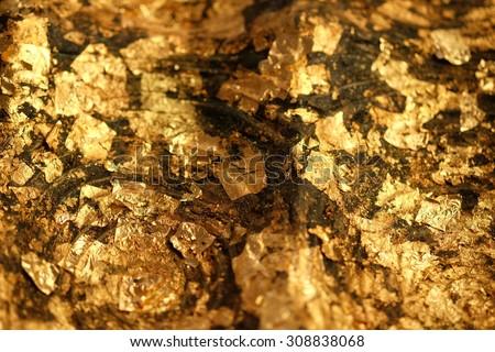 Gold Leaf ,Gold paper texture on Buddha sculpture