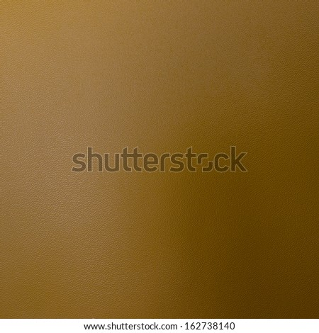 Gold leather texture closeup. Useful as background for design-works.